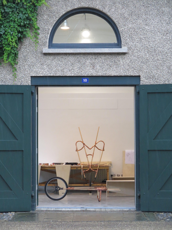 Wheelbarrow frame inside stable doors