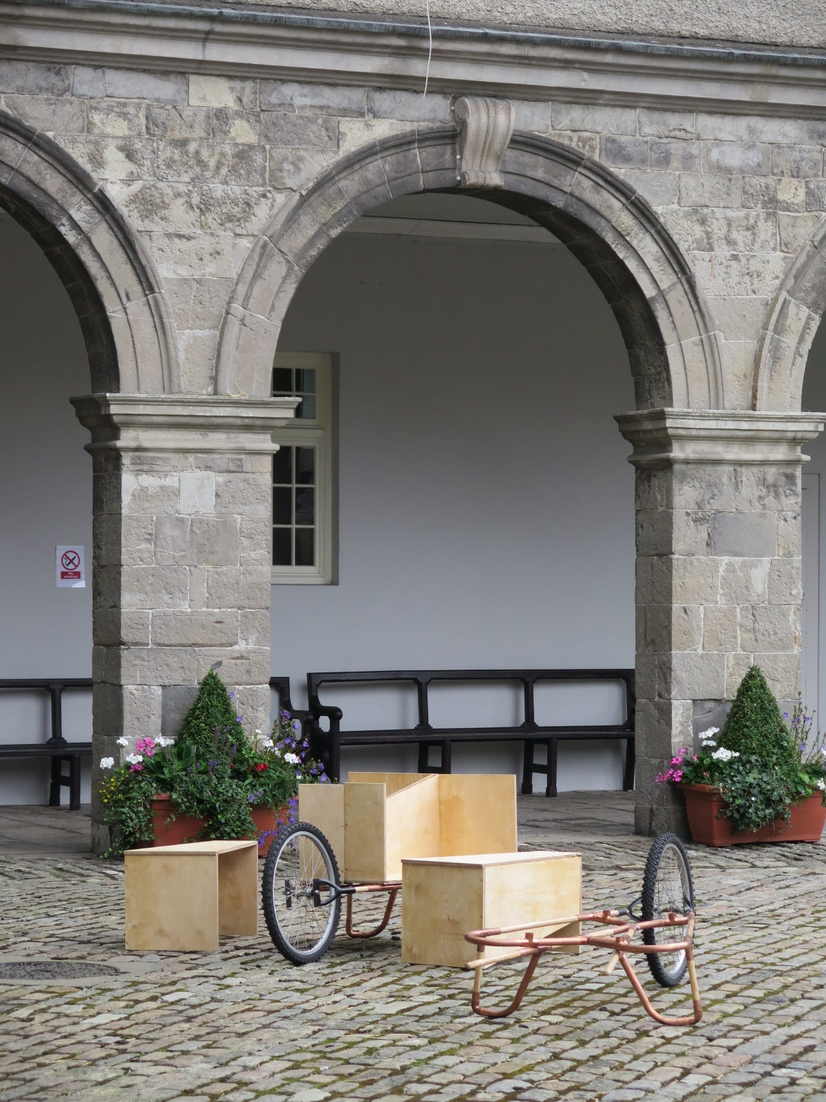 wheelbarrow and mobile bench in IMMA Courtyard
